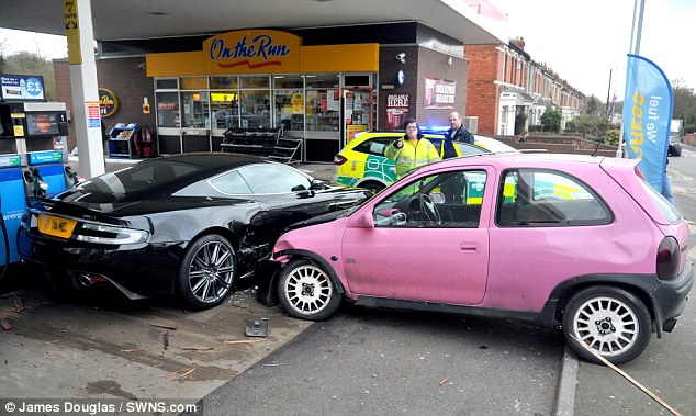 Pink Corsa crashed into black Aston Martin DBS - 1